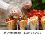 pastry chef is decorating ice... | Shutterstock . vector #1104841433