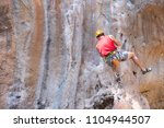 young man looking up while... | Shutterstock . vector #1104944507