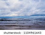 waves of the baltic sea under a ... | Shutterstock . vector #1104961643