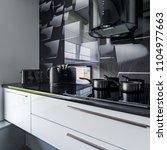 modern kitchen with white... | Shutterstock . vector #1104977663