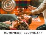 tibetan singing bowl in sound... | Shutterstock . vector #1104981647