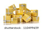 Many gold gifts in a pile on white - stock photo