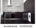 Part of black hardwood kitchen with build-in domestic technique - stock photo