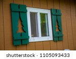 cabin window shutters green... | Shutterstock . vector #1105093433