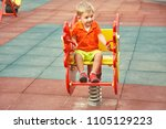 funny little boy on playground. ... | Shutterstock . vector #1105129223