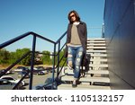 outdoor portrait of a stylish... | Shutterstock . vector #1105132157