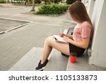 girl writing pen in notebook.... | Shutterstock . vector #1105133873