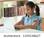 asain kid using laptop in... | Shutterstock . vector #1105148627
