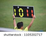 Small photo of Assistant referee hold up substitution board