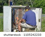 Small photo of Greenville,SC/USA-June 4 2018: A communications worker trouble shoots a problem in a telephone cross box node. This node is wired with copper wire.