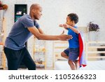 father lifting son up with... | Shutterstock . vector #1105266323