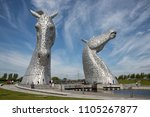 Small photo of Falkirk, Scotland - May 19, 2018: The Kelpies sculpture by Andy Scott in Helix Park with admiring people