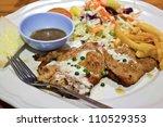 pork steak with salad  french...