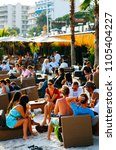 Small photo of JUAN LES PINS.FRANCE-JUNE 4,2011: people enjoy a drink at heliox plage in juan les pins, france