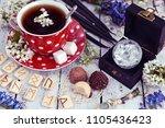 cup of flower tea with runes ...   Shutterstock . vector #1105436423