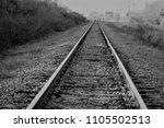 Small photo of Black and white, the railway tracks create leading lines and disappeared at end. Created in Orlando, FL, 01/15/2018