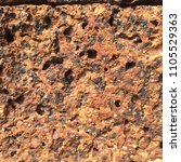 Small photo of ancient laterite surface wall texture stone blackground