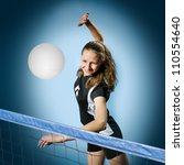 female volleyball player with a ball - stock photo