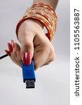 woman holding pen drive | Shutterstock . vector #1105563887