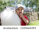 funny little boy eating cotton... | Shutterstock . vector #1105664393