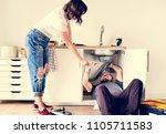 couple fixing kitchen sink | Shutterstock . vector #1105711583