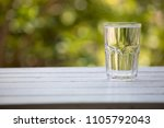 glass of water on wood table | Shutterstock . vector #1105792043