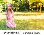 little girl eating fruity ice... | Shutterstock . vector #1105814603