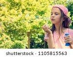 cute girl blowing soap bubbles... | Shutterstock . vector #1105815563