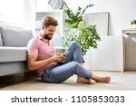 happy  relaxed man at home... | Shutterstock . vector #1105853033