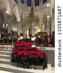 Small photo of New York, NY, USA January 3, 2018 The steps leading to the alter of St. Patrick's Cathedral in New York City is adorned with poinsettias for the Christmas holiday.