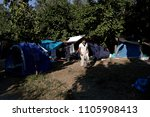 refugees and migrants rest in... | Shutterstock . vector #1105908413