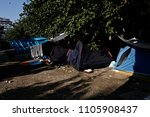 refugees and migrants rest in... | Shutterstock . vector #1105908437