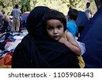 children among tents on aug. 3  ... | Shutterstock . vector #1105908443