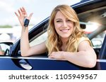 an attractive woman in a car... | Shutterstock . vector #1105949567
