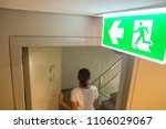 emergency fire exit sign at ... | Shutterstock . vector #1106029067