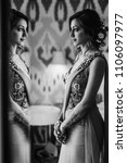 Small photo of Portrait of beautiful Hindu bride in a sari getting sitting in a hotel room