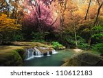 Waterfall And Blue Stream In...
