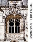 Small photo of Sintra, Portugal - July, 2015: Close up of a very ornate window in the Regaleira Palace. A neo-manueline palace decorated with alchemy and freemasons symbols.