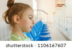 a girl on the podium watching... | Shutterstock . vector #1106167607