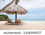 sun loungers with umbrella on a ... | Shutterstock . vector #1106304527