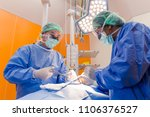 surgeon performing operation in ... | Shutterstock . vector #1106376527