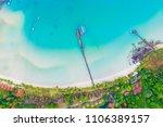 seashore blue ocean with green... | Shutterstock . vector #1106389157