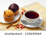 Cup of coffee with cupcake - stock photo