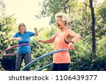 senior woman exercising with a... | Shutterstock . vector #1106439377