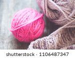 yarn on wooden background... | Shutterstock . vector #1106487347