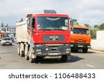 Small photo of Sochi, Russia - July 27, 2009: Red dump truck MAN TGA in the city street.