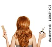 Beautiful curly hair and hairdresser's tools - stock photo