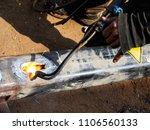 metal work. man cuts a hole in... | Shutterstock . vector #1106560133