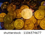 golden eos.io and mound of...   Shutterstock . vector #1106574677