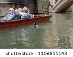 Small photo of CAMBRIDGE, UNITED KINGDOM - MAY 31, 2018: Unidentified people enjoying tourist punt trips on the River Cam